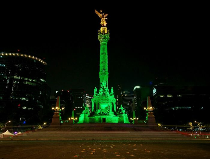 Angel de independencia , CDMX Night Illuminated Statue Sculpture No People Architecture Built Structure Outdoors City Cityscape Sky Nightphotography Night Lights Nightlife Cityicon Visit Mexico Cdmx Mexico Travel Destinations Night View Nightshot Nightscape Green Gold Skyscrapers