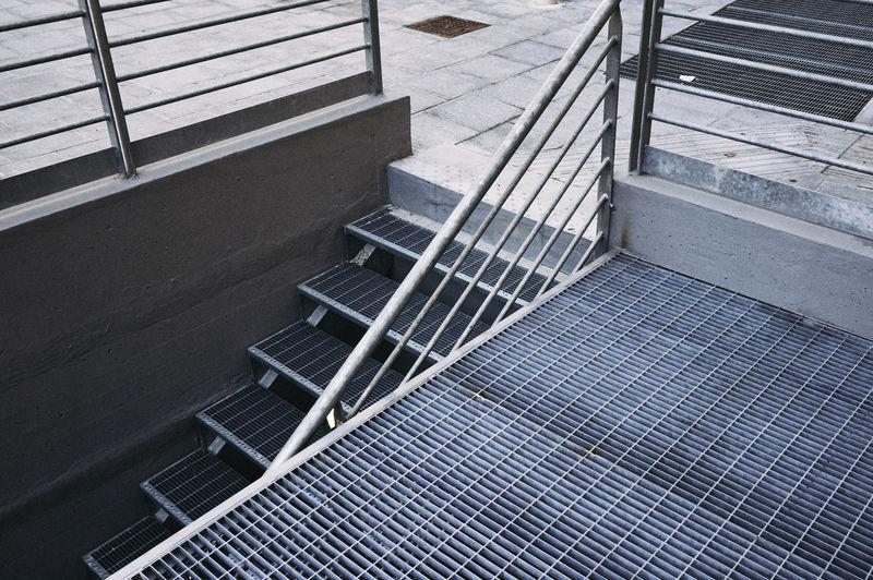 Narrow Stairs Along Railings