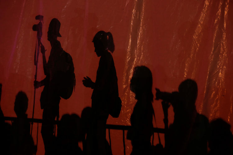Silhouette people on stage