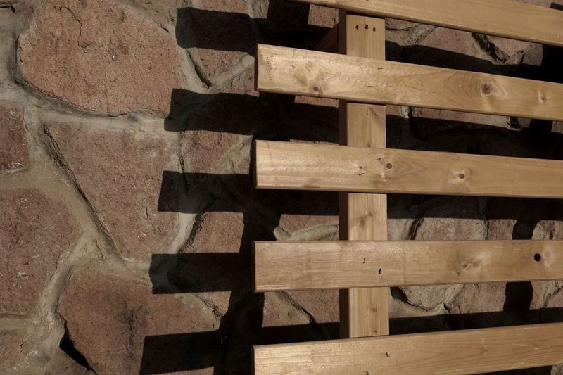 High angle view of pallet on stone wall