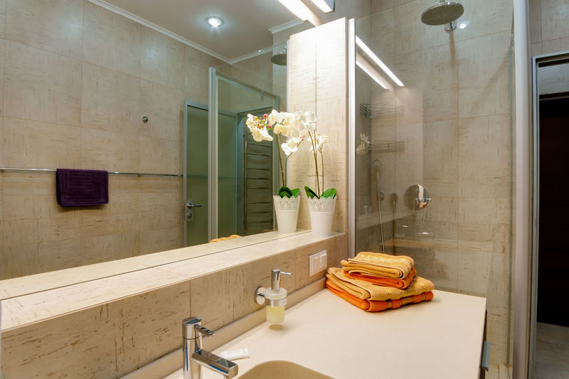 Indoors  Bathroom Domestic Room Mirror Domestic Bathroom Sink Luxury No People Household Equipment Illuminated Faucet Modern Home Architecture Wealth Home Interior Bathtub Reflection Hygiene Absence Flooring