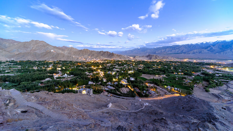 Panoamic view of Leh during a sunset, view from Shanti Stupa. Altitude is 3,666 meters, India India Lights Architecture Beauty In Nature Building Building Exterior Built Structure City Cloud - Sky Day Environment Land Landscape Mountain Mountain Range Nature No People Outdoors Scenics - Nature Sky Snowcapped Mountain Sunset Tranquil Scene Tranquility Travel Destinations