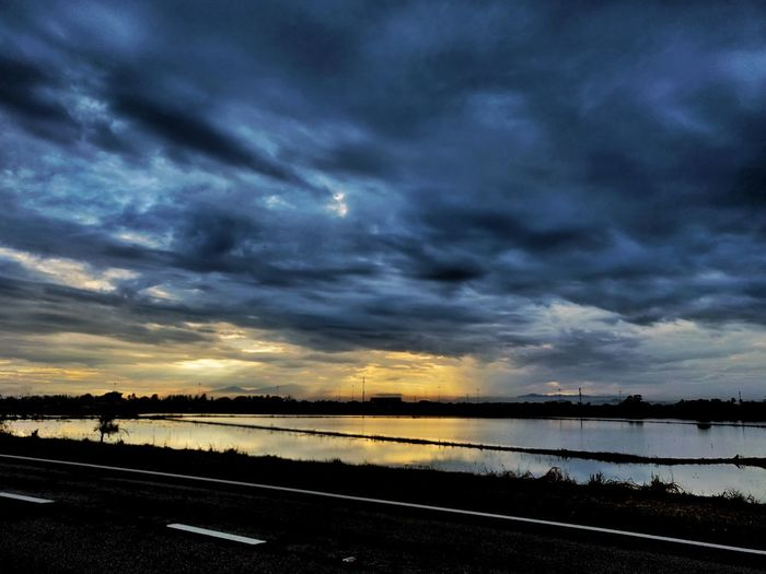 Cloudy skies with a reflection paddy field lake.. Paddy Reflection Cloudy Moody Scenic View Atmosphere Penang Malaysia Lake Blue Gold Silhouete Astronomy Water Sea Sunset Dramatic Sky Sky Cloud - Sky Landscape Horizon Over Water Calm