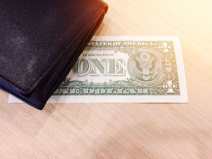 US dollar for use in everyday life Bag Buying Sale Shopping Using Hope Marketing Business Pay Richness USA Wachington D.C New York City United American One Dollar  US Dollar Dollar Money Paper Currency Currency Finance Wallet Wealth High Angle View No People Savings Close-up Day Indoors