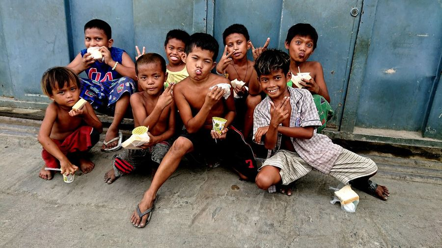 Seeing them happy makes me feel happy too. #communityoutreach#program Community Outreach Helpinghands Friendship Full Length Sitting Water Portrait Children The Street Photographer - 2018 EyeEm Awards