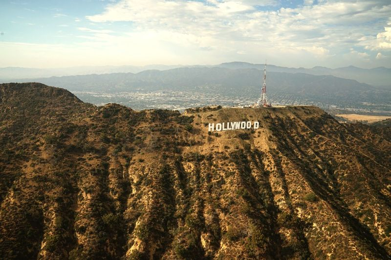 Hollywood Sign from Helicopter SONY A7ii Helicopter View  Hollywood Sign Dukkart Communication Building Exterior Built Structure Sky Architecture Tower Nature No People Sign Building Mountain Guidance Cloud - Sky Beauty In Nature Land Outdoors