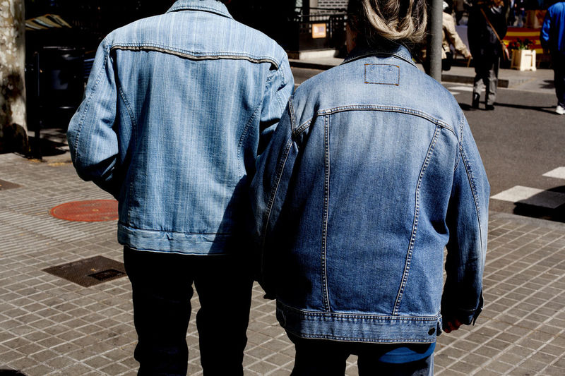 His and hers denim jackets, Barcelona, Spain. Barcelona Couple Denim Denim Jacket Friends ❤ Hand In Hand His And Hers Horizon Over Water Horizontal Old People Same  Similar Streetphotography Togetherness Two People Urban Walking
