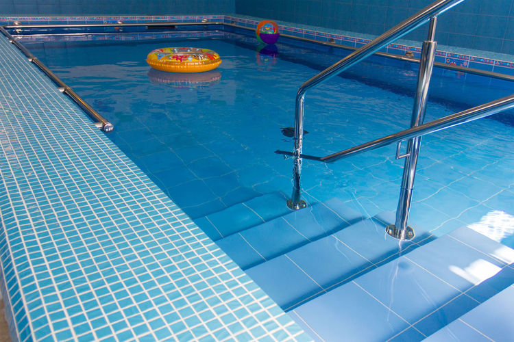 Children's Lifebuoy Stairs Stairway Into The Water Pool Stairs Swimming Blue Day High Angle View No People Swimming Pool Water