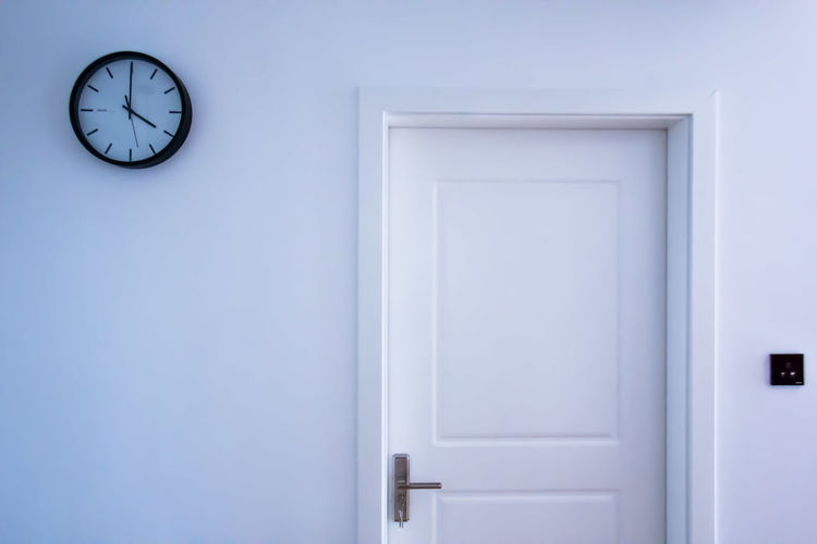 Clock on wall by door at home