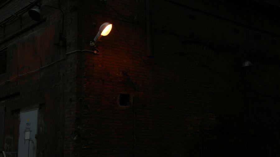 Low angle view of illuminated street light at night