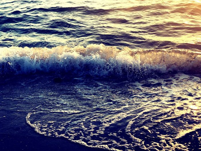 I see beauty in such simple things. Wave Water Sea Nature No People Beauty In Nature Outdoors Waterfront Power In Nature Reflection Rippled Sunlight Wake Motion Scenics Day Crash