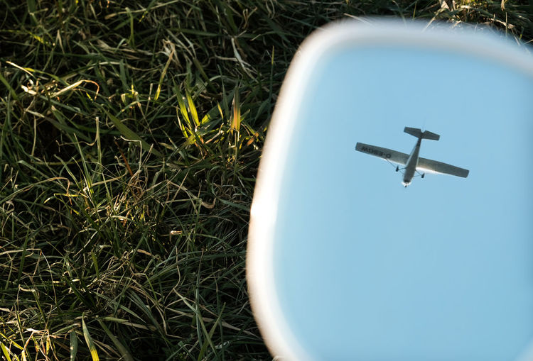 Close-up of airplane in grass