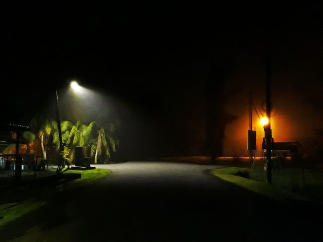 EyeEmNewHere Dark Footpath Light Lighting Equipment No People Outdoors Road Street Street Light The Way Forward