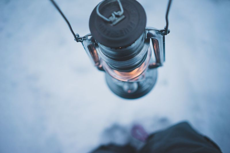 High Angle View Of Lantern Over Snow