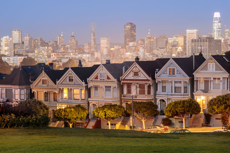 Dusk over the Painted Ladies of San Francisco. Iconic Victorian Houses and San Francisco Skyline in Alamo Square, San Francisco, California, USA. Architecture Built Structure Building Exterior Building City Residential District Sky Landscape House Office Building Exterior Skyscraper Cityscape Tower Urban Skyline Tall - High Grass Travel Destinations Outdoors Modern Painted Ladies Alamo Square San Francisco Victorian Downtown District Tourism