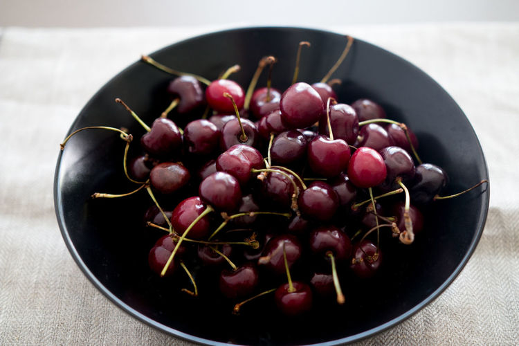 Black Bowl Black Plate Bowl Cherries Cherry Cherry Fruits Close Up Food Close-up Eating Healthy Food Food Photography Fresh Fruits Front View Fruit Fruit On Table Fruit Table Healthy Eating Horizon Over Water Plate Purple Serving Fuits Serving Size Summer Food Table