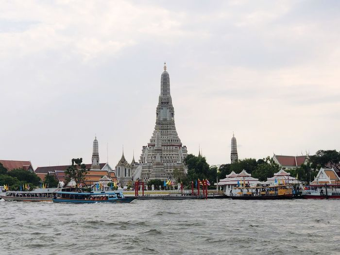 Wat Arun Chao Phaya River Temple In Thailand River Architecture Built Structure Sky Building Exterior Building Cloud - Sky Travel Destinations Tourism