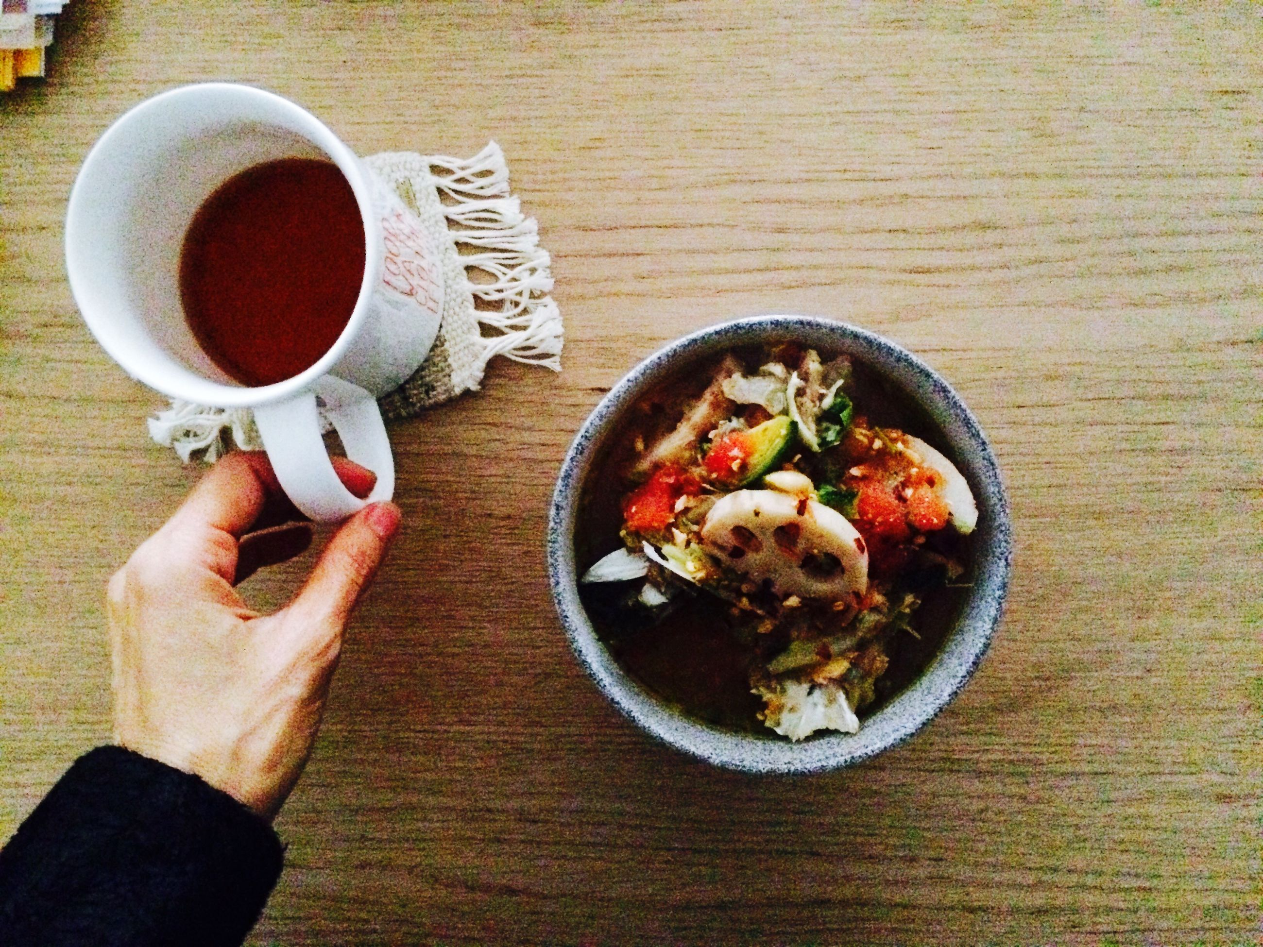 food and drink, food, freshness, person, table, indoors, holding, drink, healthy eating, plate, ready-to-eat, part of, refreshment, coffee cup, high angle view, cropped, personal perspective