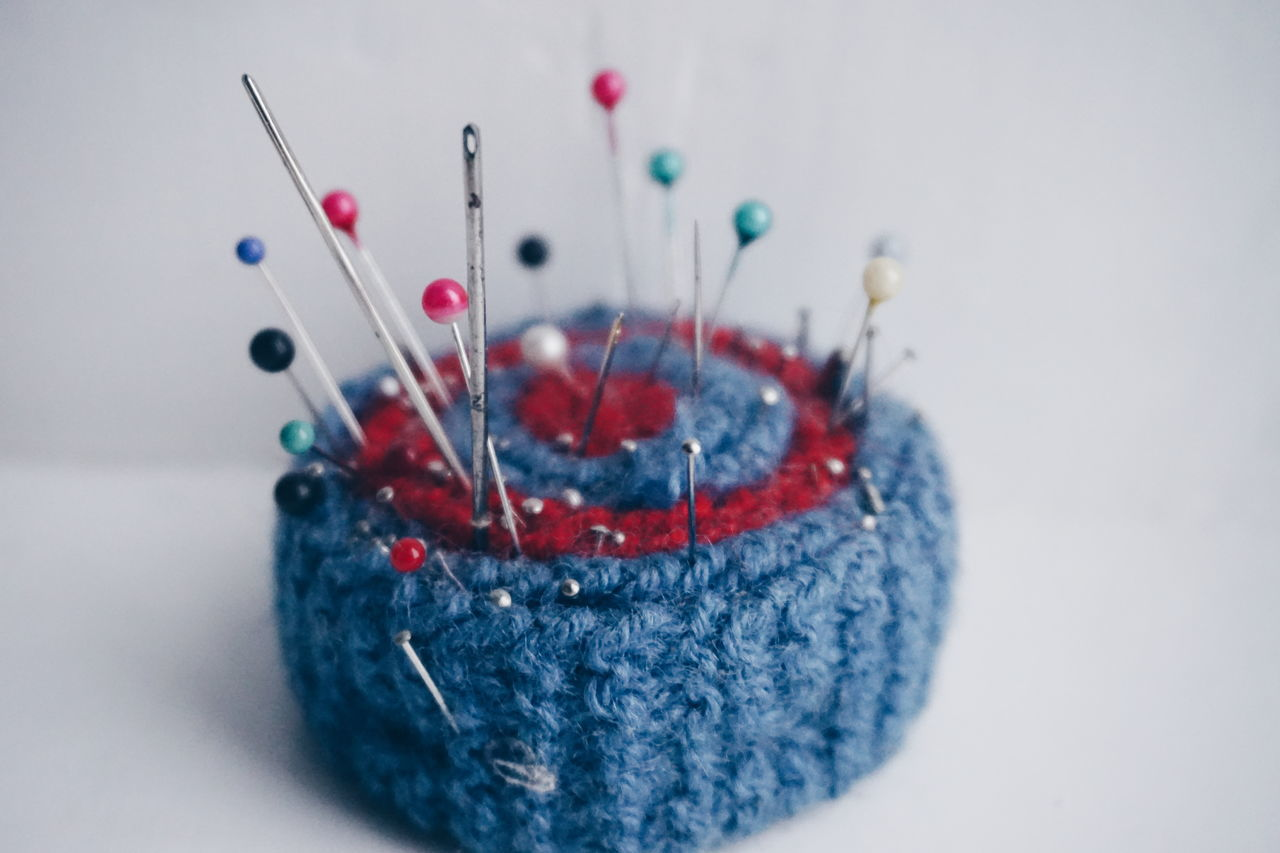 art and craft, multi colored, sewing, no people, studio shot, close-up, sewing item, indoors, white background, wool, needle, day
