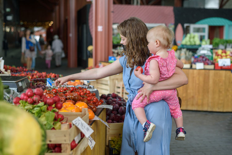 Woman with fruits at market stall
