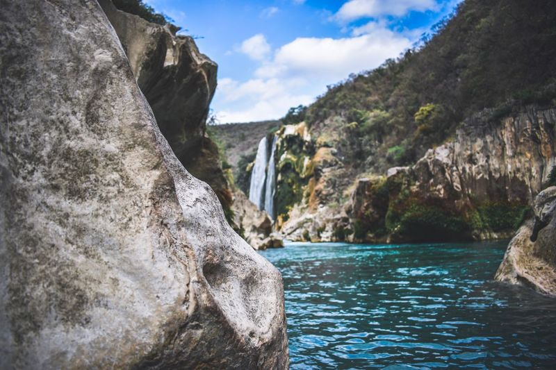 Water Beauty In Nature Scenics - Nature Nature Rock Sky Day Tranquility Cloud - Sky Mountain River Plant Waterfall Outdoors Flowing Water