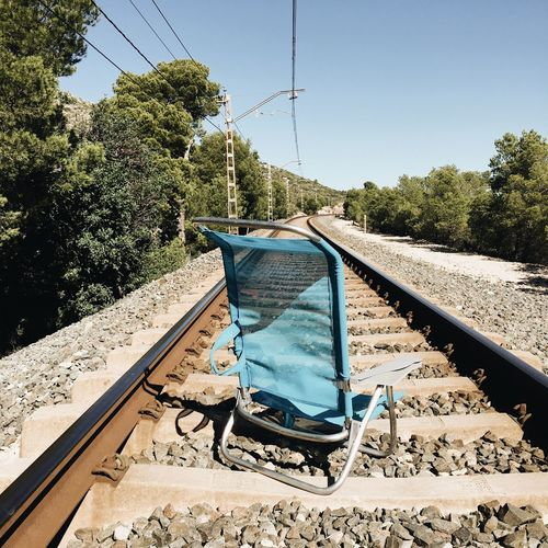 Travel Square Adventure Chair Trip Travel Rail Sky Tree Nature Plant Day Clear Sky No People Sunlight Outdoors Land Railroad Track Rail Transportation