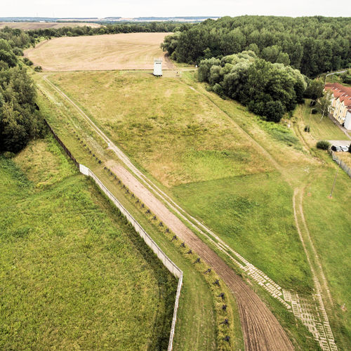 The former border area between West Germany and the GDR, open-air exhibition at Hötensleben, aerial photo taken at an angle, made with drone AERA Drone  GDR Aereal View Aerial Aerial View Agriculture Beauty In Nature Border Day Exhibition Field Former Grass High Angle View Landscape Nature No People Outdoors Road Rural Scene Scenics Tranquil Scene Tree