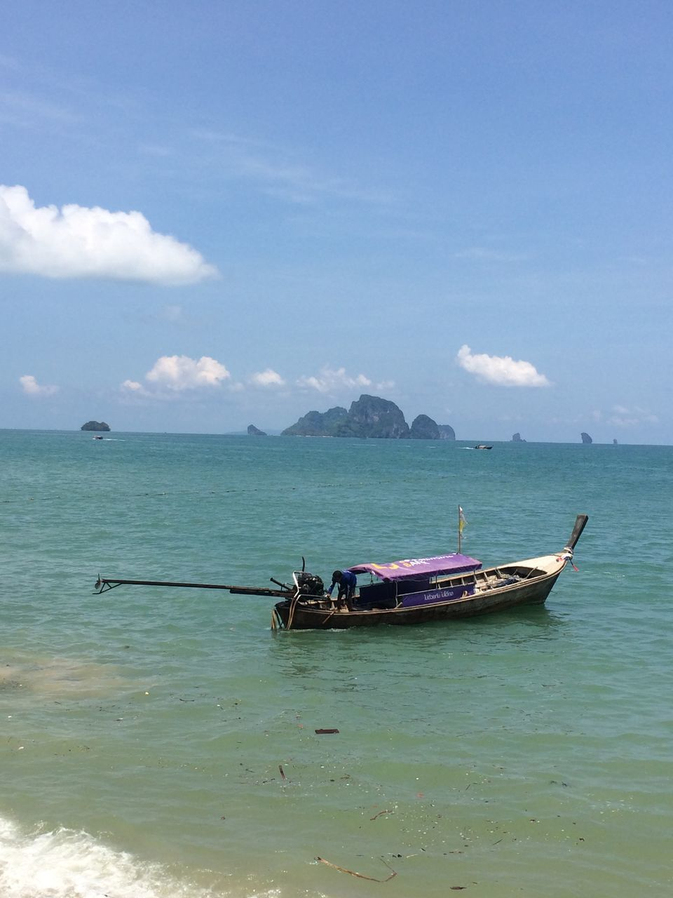 transportation, nautical vessel, water, mode of transport, boat, sky, nature, sea, day, scenics, outdoors, beauty in nature, horizon over water, moored, outrigger, longtail boat, no people