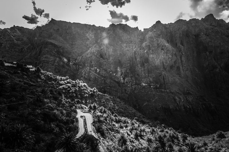 Our story is full of hairpin turns. Sudden corners. And tall blocking mountains. We like it that way. #persevere Winding Road Masca Village Masca Valley Road Masca Road Teno Countryside Adventure People Car Monochrome Black And White Tenerife Island Tenerife Landscape Mountain Mountains Road Nature Mountain Nature Day Tranquility Beauty In Nature Landscape Outdoors Sky Mountain Range