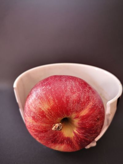 High angle view of apple on table against black background