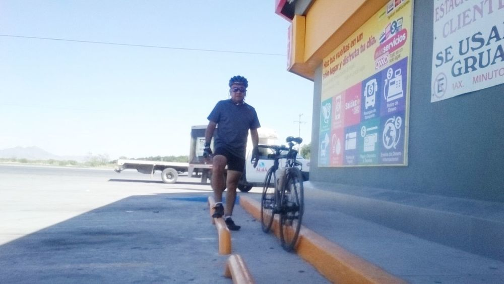 Transportation One Man Only Only Men One Person Adult Riding Headwear Rear View Adults Only Day Full Length Cycling People Road Men Mature Adult Outdoors Young Adult One Young Man Only Sky Carbon Fiber Coahuila, México Desert Comarca Lagunera Sport