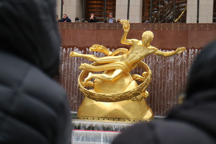 Belief Art And Craft Spirituality Religion Architecture Place Of Worship Built Structure Rear View Gold Colored Sculpture Focus On Background Representation Building Human Representation Statue Selective Focus Creativity Craft Male Likeness Ornate