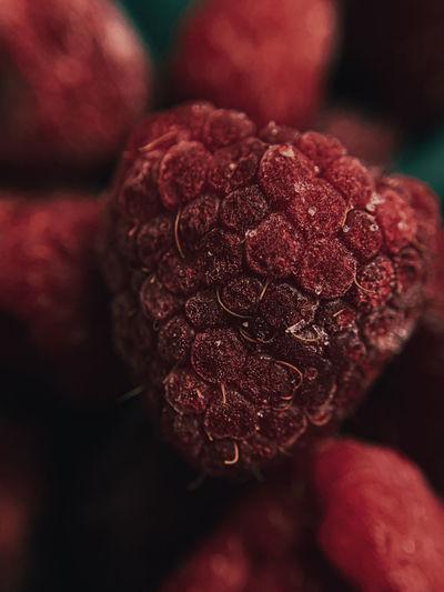 Photo of a macro raspberry on a dark background