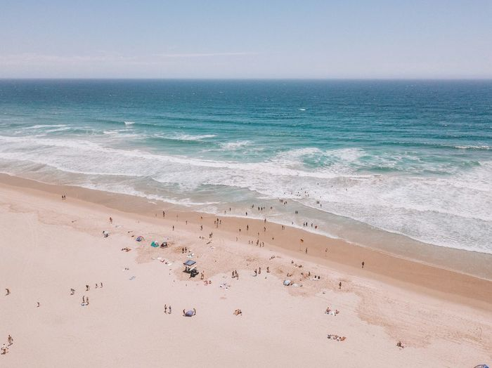 Land Beach Sea Water Wave Sand Sky Beauty In Nature Nature Sport Motion People Surfing Holiday Vacations Trip Aquatic Sport Summer Travel Outdoors