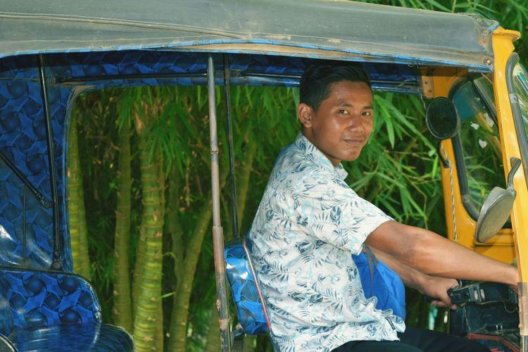 Portrait of young man driving jinrikisha