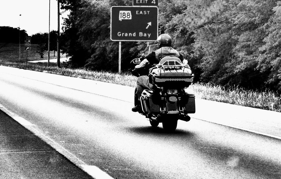 Biker. One Person Day Road People Outdoors Road Sign