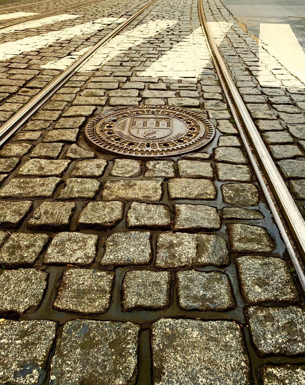 HIGH ANGLE VIEW OF RAILROAD TRACK ON STREET