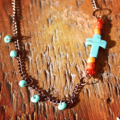 Southern charm necklace with turquoise cross and red and orange glass beads Bohojewelry Buylocal Peterborough Countrychic cowgirl countryjewelry countrygirl southernbell rustic redneckwomen womenhunters huntress cross