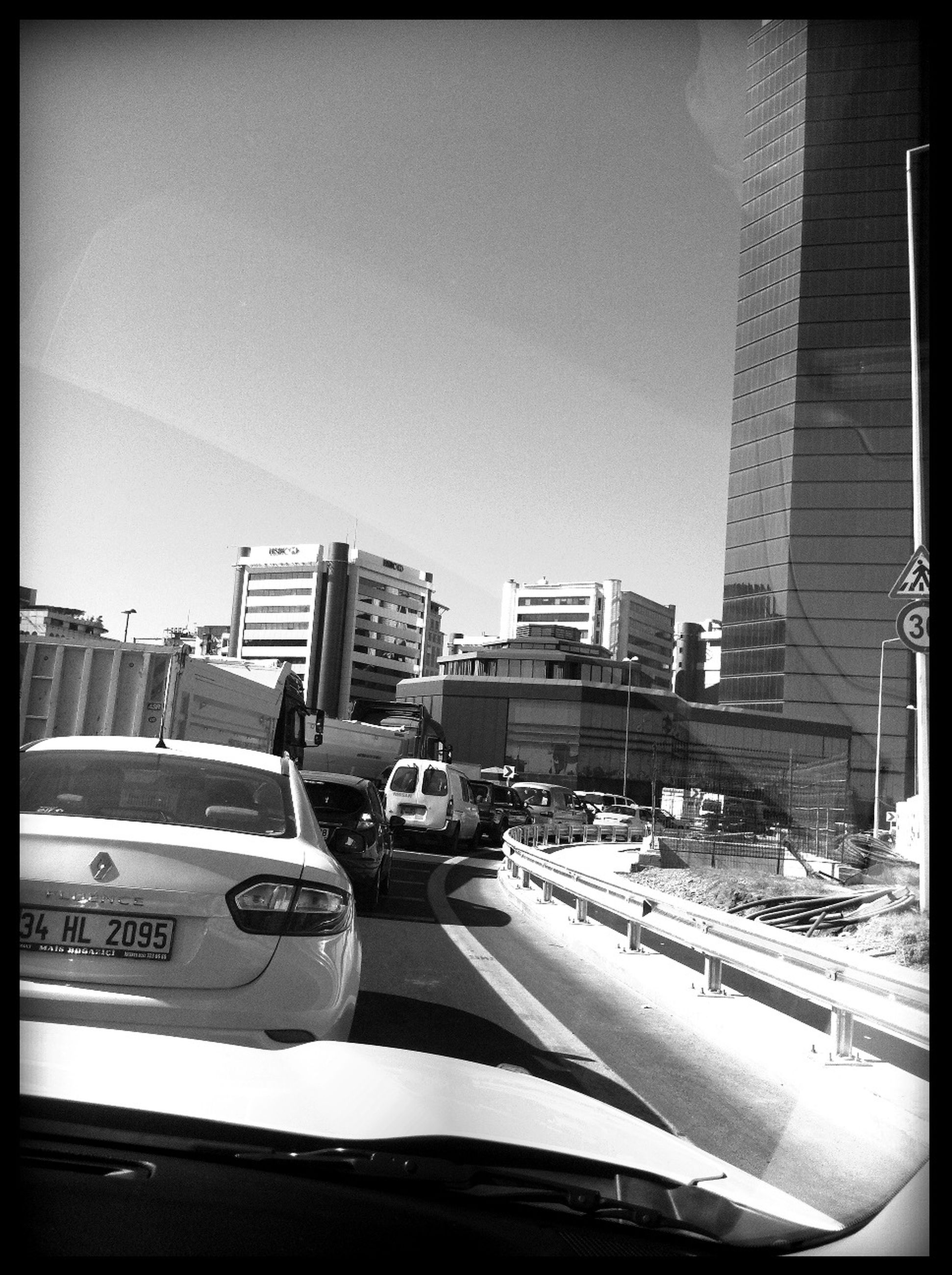 transfer print, transportation, car, building exterior, mode of transport, architecture, land vehicle, city, built structure, auto post production filter, clear sky, road, street, traffic, city life, travel, city street, day, on the move, sky