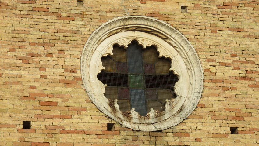 the old church rose window Antique Arch Architecture Brick Wall Built Structure Cathedral Church Close-up Day Geometric Shape Glass Medieval Architecture Multicolor No People Religious Architecture Rose Window