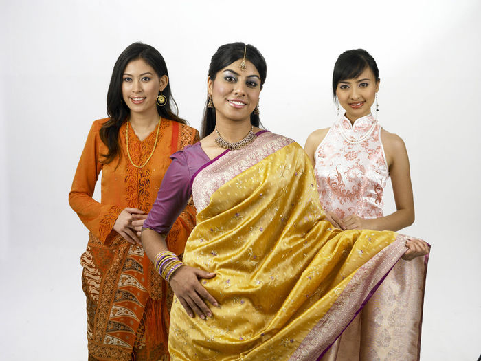 malaysia young woman in traditional costumes Friends Indian Traditional Clothing Baju Kebaya Beautiful Woman Bubby Cheongsam Chinese Friendship Front View Happiness Harmony Malay Ethnicity Malaysian Merdeka Mixed Race Multi Racial Racial Sari Smiling Together Togetherness United White Background Women