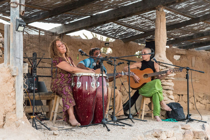 Mitzpe Ramon, Israel, July 27, 2018 : The amateur musical group performs on an improvised stage under a canopy in the city of Mizpe Ramon in Israel Art Artist Band Canopy Celebration Drum Live Music Show Adult Amateur Musical Group Concert Entertainment Festival Group Of People Guitar Guitarist Improvised Stage Israel Music Musical Instrument Musician Performs Playing Scene Song