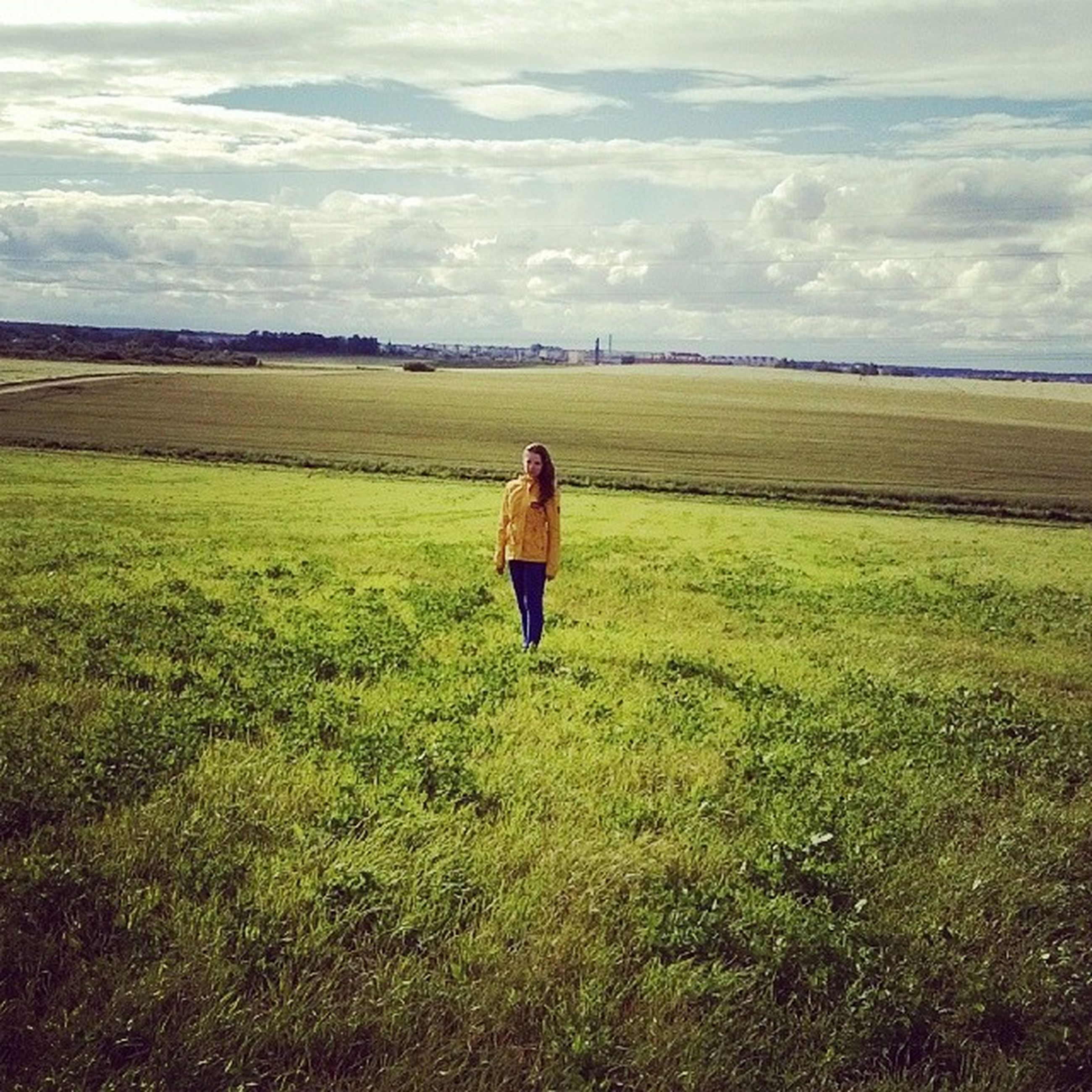 grass, field, sky, rear view, lifestyles, full length, leisure activity, landscape, casual clothing, tranquility, standing, tranquil scene, grassy, green color, nature, cloud - sky, beauty in nature, scenics