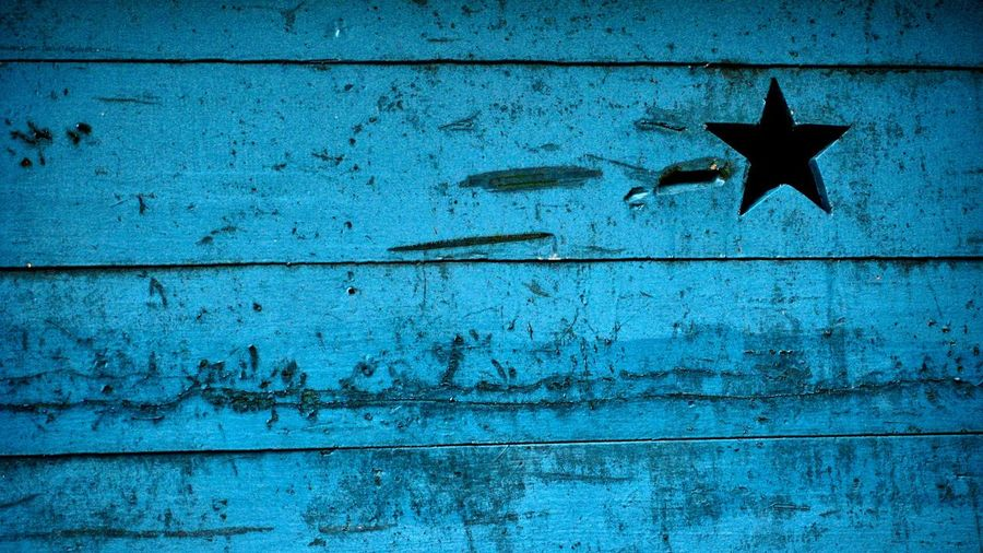 Close-up of star shape on wooden wall