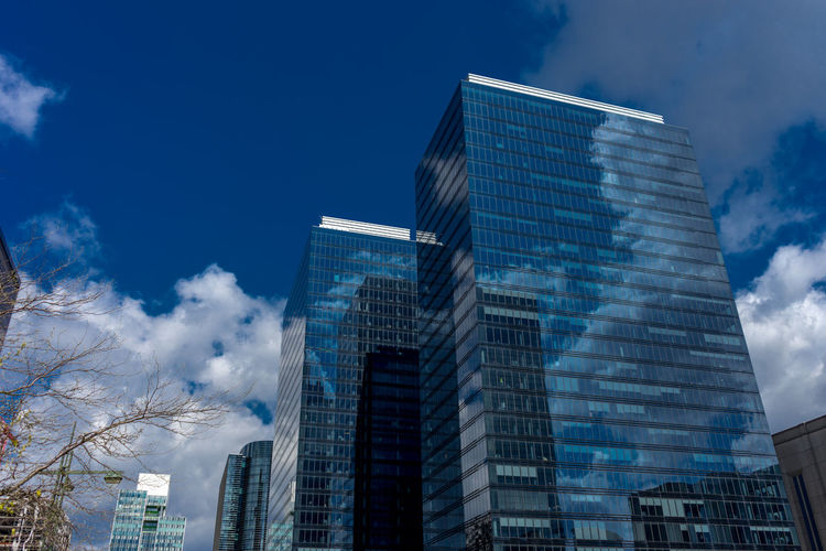 Architecture Blue Building Building Exterior Built Structure City Cloud - Sky Day Financial District  Glass - Material Low Angle View Modern Nature No People Office Office Building Exterior Outdoors Sky Skyscraper Tall - High Tower