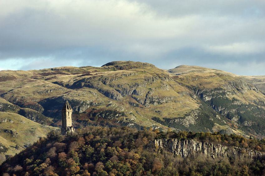 The National Wallace Monument overlooking the scene of Scotland's victory at The Battle of Stirling Bridge. Architecture Autumn Autumn Colors Scotland Sterling Autumn🍁🍁🍁 Cloud - Sky Day Landscape Mountain Nature No People Outdoors Scenics Scotlandsbeauty Sky Tranquil Scene Tranquility