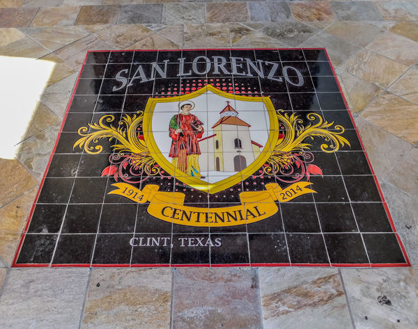 San Lorenzo, Catholic Church, Clint Texas. Saint Lorenzo is the Patron Saint of Cooks Text Communication Western Script High Angle View No People Day Sign Flooring Representation Capital Letter Human Representation Information Yellow Outdoors Tile Information Sign Non-western Script Creativity Art And Craft Architecture Message Tiled Floor