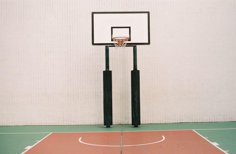 Basketball hoop against wall