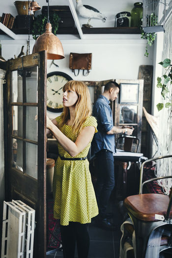 Woman standing by window in store
