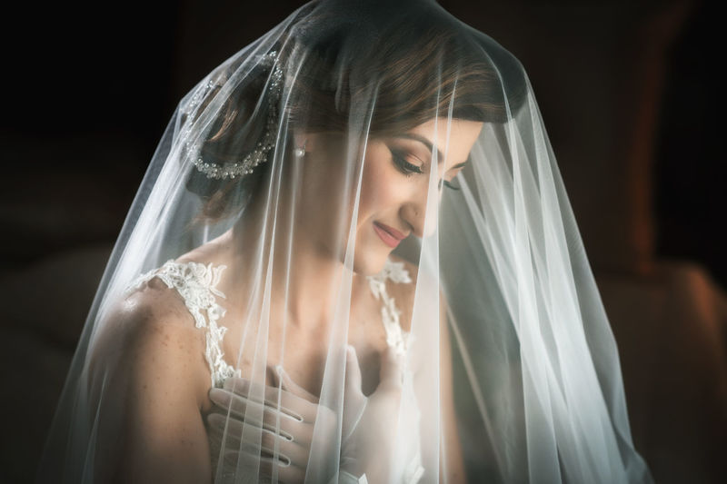 Adult Beautiful Woman Bride Celebration Contemplation Event Hairstyle Headshot Life Events Looking Looking Down Newlywed One Person Portrait Veil Wedding Wedding Dress Women Young Adult Young Women